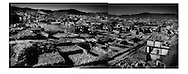 Diptych: Demolition of Dukezong, the old, wooden Tibetan town in Zhongdian, shortly after the devastating January 2014 fire.  Yunnan, China (Kham, Tibet).  It is believed the fire started in a small hotel in the middle of the night.  Gail-force winds fanned the fire and narrow alleyways prevented fire fighters getting equipment in to fight the fire and so much of the firefighting effort was done by residents forming lines and passing buckets of water to be dumped on the fire.  Sub-freezing temperatures were said to have dimished fire hydrant water pressure and the result was this catastrophe.