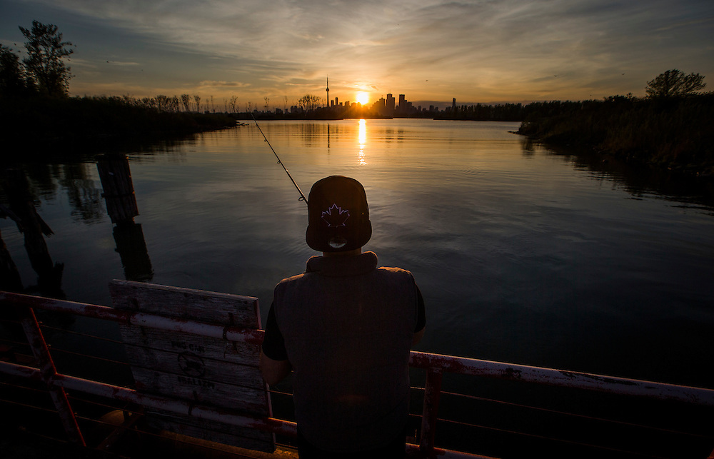 Hasan Mohammad fishes at Tommy Thompson Park in Toronto, May 26, 2015.    REUTERS/Mark Blinch