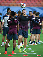 Ross Barkley of England warms up during the England open training session at Arena da Amazonia, Manaus, Brazil. <br /> Picture by Andrew Tobin/Focus Images Ltd +44 7710 761829<br /> 13/06/2014