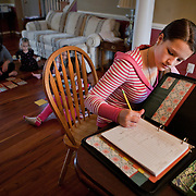 Marybeth Foss, 15, sister of Patrick does her schoolwork. Patrick Foss, 17, an accomplished soccer player, does not play on his local high school's soccer team. Named for home-schooled Broncos quarterback Tim Tebow who played sports at his local high school, a new bill could give home-schooled students the chance to play on local school teams.