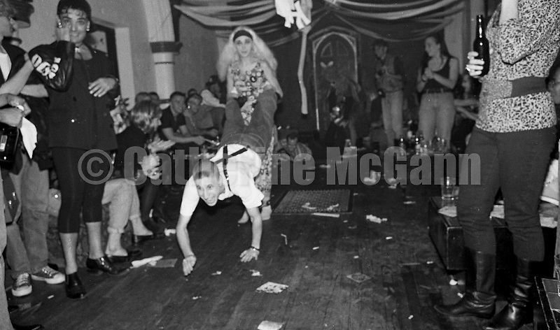 Oct 17,1990:  Two club goers have a wheelbarrow race at the Limelight nightclub in New York City, New York.