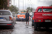 09.MARCH.2014. HURGHADA<br /> <br /> CODE - JEZ<br /> <br /> RESIDENTS AND BUSINESSES WERE TAKEN UNAWARES TODAY WHEN A STORM HIT THE RESORT CITY OF HURGHADA ON THE RED SEA, EGYPT.  RAIN OF SUCH MAGNITUDE HAD NOT BEEN SEEN THERE FOR MANY, MANY YEARS, &ldquo;FOURTEEN YEARS&rdquo; SAID MOST, WITH A FEW OTHERS BELIEVING THAT THEY HADN&rsquo;T SEEN ANYTHING LIKE IT IN TWENTY YEARS. ROAD CLOSURES, HOUSES AND SHOPS WERE FLOODED.<br /> <br /> THE RESIDENTS DID ALL THEY COULD, WITH MAKESHIFT SAND BAGS AND BALING OUT AS MUCH WATER AS THEY COULD WITH ANY RECEPTACLES THEY COULD LAY THEIR HANDS ON.<br /> <br /> HURGHADA IS NOT KNOWN FOR HAVING AN ARRAY OF UMBRELLA AND WELLINGTON BOOT STORES!<br /> <br /> BYLINE: EDBIMAGEARCHIVE.CO.UK<br /> <br /> *THIS IMAGE IS STRICTLY FOR UK NEWSPAPERS AND MAGAZINES ONLY*<br /> *FOR WORLD WIDE SALES AND WEB USE PLEASE CONTACT EDBIMAGEARCHIVE - 0208 954 5968*