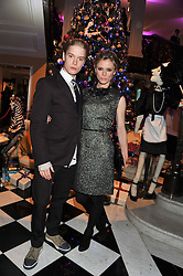 FREDDIE FOX and EMILIA FOX at the unveiling of the Claridge's Christmas tree 2011 designed by Alber Elbaz for Lanvin held at Claridge's, Brook Street, London on 5th December 2011.
