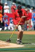 ANAHEIM - APRIL 10:  A groundskeeper rakes the pitcher's mound dirt prior to the game between the Toronto Blue Jays and the Los Angeles Angels of Anaheim at Angel Stadium in Anaheim, California on Sunday April 10, 2011. The Angels won the game 3-1. (Photo by Paul Spinelli/MLB Photos via Getty Images)