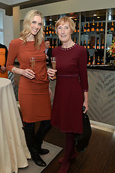 Left to right, CHRISTINA JESAITIS and PATRICIA VAZ at a dinner in honour of Veuve Clicquot Business Woman Award UK Previous Winners held at Moet Hennessy, 18 Grosvenor Gardens, London on 8th April 2014.