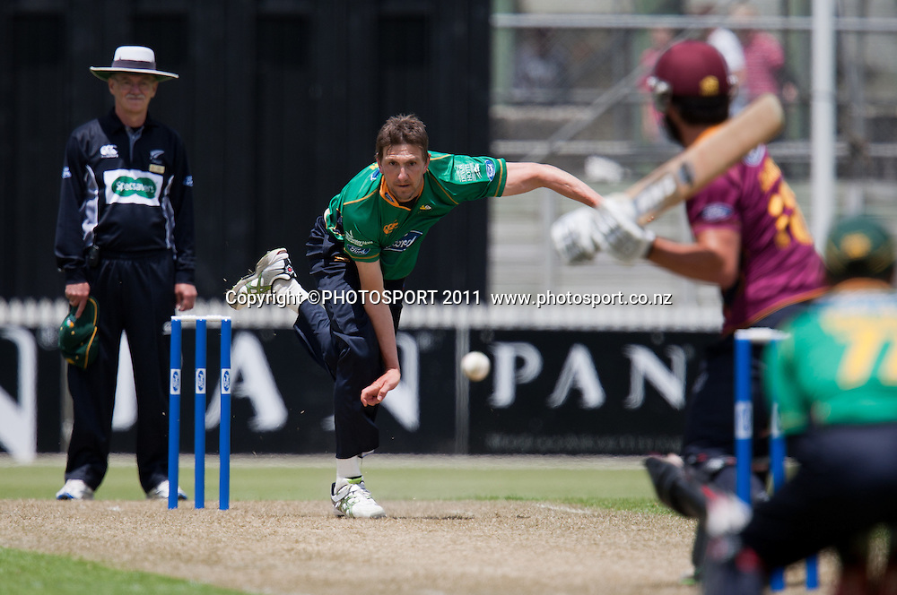 Stags' Michael Mason bowls to Anton Devcich during the Ford Trophy Cricket - Northern Knights v Central Stags one day match, at Seddon Park, Hamilton, New Zealand, 11 December 2011. Photo: Stephen Barker/photosport.co.nz
