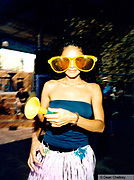 Girl wearing big yellow glasses and a grass skirt, Space, Ibiza 1999
