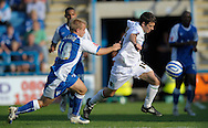Picture by Ady Kerry/Focus Images Ltd.  .26/09/09.Gillingham's Dammy Jackman  challenges Norwich's Wes Hoolahan during their Coca-Cola League 1 game at the Priestfield Stadium, Gillingham, Kent.