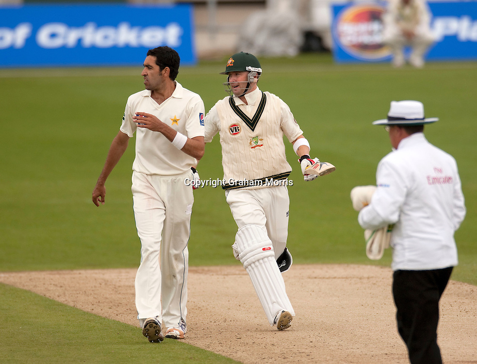 Michael Clarke runs past bowler Umar Gul during the second MCC Spirit of Cricket Test Match between Pakistan and Australia at Headingley, Leeds.  Photo: Graham Morris (Tel: +44(0)20 8969 4192 Email: sales@cricketpix.com) 23/07/10