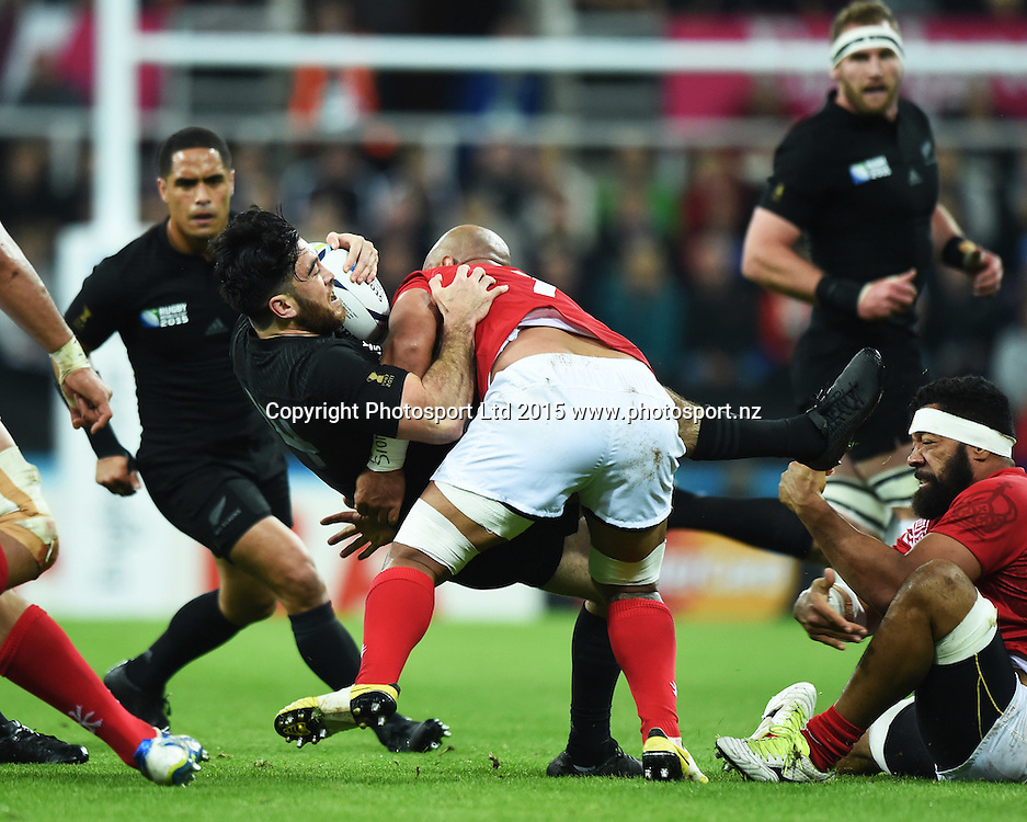 Nehe Milner-Skudder is tackled during the New Zealand All Blacks v Tonga Rugby World Cup 2015 match. St James' Park in Newcastle. UK. Friday 9 October 2015. Copyright Photo: Andrew Cornaga / www.Photosport.nz