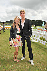 POPPY DELEVINGNE and JAMES COOKE at the 2009 Veuve Clicquot Gold Cup Polo final at Cowdray Park Polo Club, Midhurst, West Sussex on 19th July 2009.