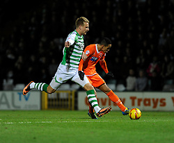 Blackpool's Thomas Ince takes a shot at goal under pressure from Yeovil Town's Byron Webster - Photo mandatory by-line: Dougie Allward/JMP - Tel: Mobile: 07966 386802 03/12/2013 - SPORT - Football - Yeovil - Huish Park - Yeovil Town v Blackpool - Sky Bet Championship
