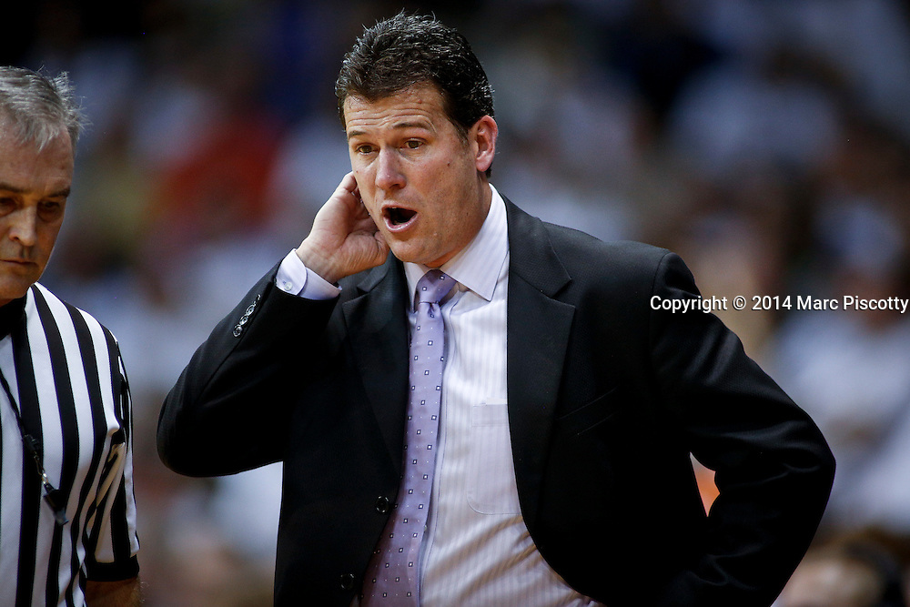 SHOT 1/16/14 8:27:47 PM - UCLA head basketball coach Steve Alford questions a call by an official while his team plays against Colorado during their regular season Pac-12 Conference basketball game at the Coors Events Center in Boulder, Co. UCLA won the game 69-56.<br /> (Photo by Marc Piscotty / &copy; 2014)