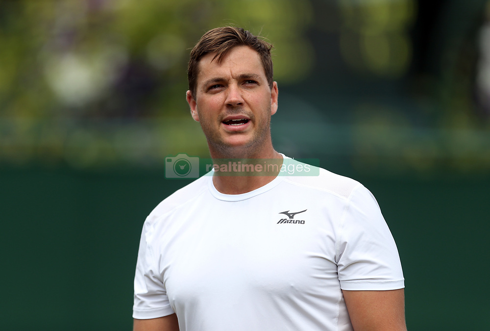 Marcus Willis speaks to the umpire during his doubles match with Jay Clarke on day seven of the Wimbledon Championships at The All England Lawn Tennis and Croquet Club, Wimbledon.