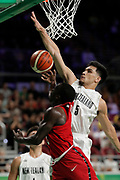 14th April 2018, Gold Coast Convention and Exhibition Centre, Gold Coast, Australia; Commonwealth Games day 10, Basketball, Mens semi final, New Zealand versus Canada; Shea Ili of New Zealand tries to block Munis Tutu of Canada from scoring with his layup