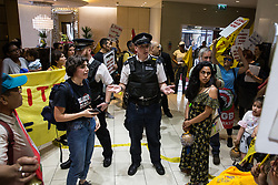 London, UK. 1 June, 2019. Members of the United Voices of the World (UVW) and Independent Workers of Great Britain (IWGB) grassroots trade unions protest inside the DoubleTree Hilton Hotel in solidarity with Dalia Quinonez Guerrero, a former cleaner from whom wages were withheld. The protest was previously arranged to have taken place outside Chanel but arrangements were changed after the global fashion chain agreed to pay its cleaners the London Living Wage at its stores.