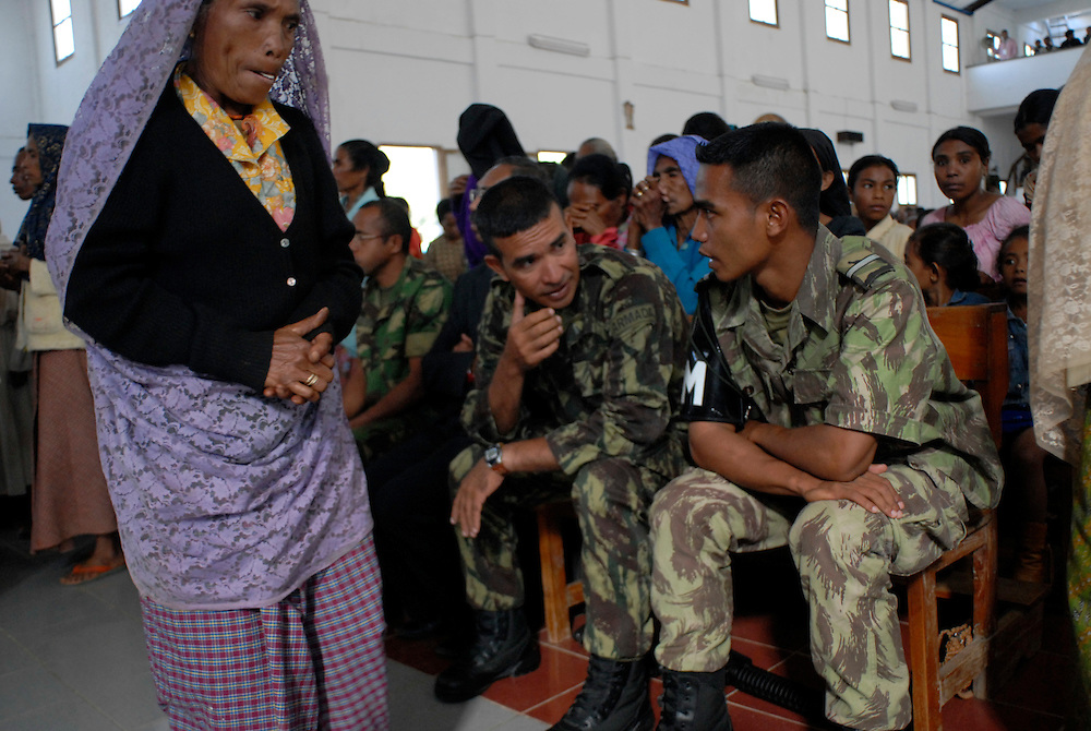 """Major Alfredo Reinado at Sunday Mass in Maubisse, East Timor,  11 June 2006. Later, at a press conference in Maubisse, rebel leaders Major Alfredo Reinado and Manuel Tilman announce they are planning a conference to seek ways of modifying East Timor's constitution to allow greater power for President Xanana Gusmao. Current Prime Minister Mari Alkitiri """"does not have the confidence of the people"""" said Tilman. """"Time is the most dangerous weapon"""" said Reinado."""