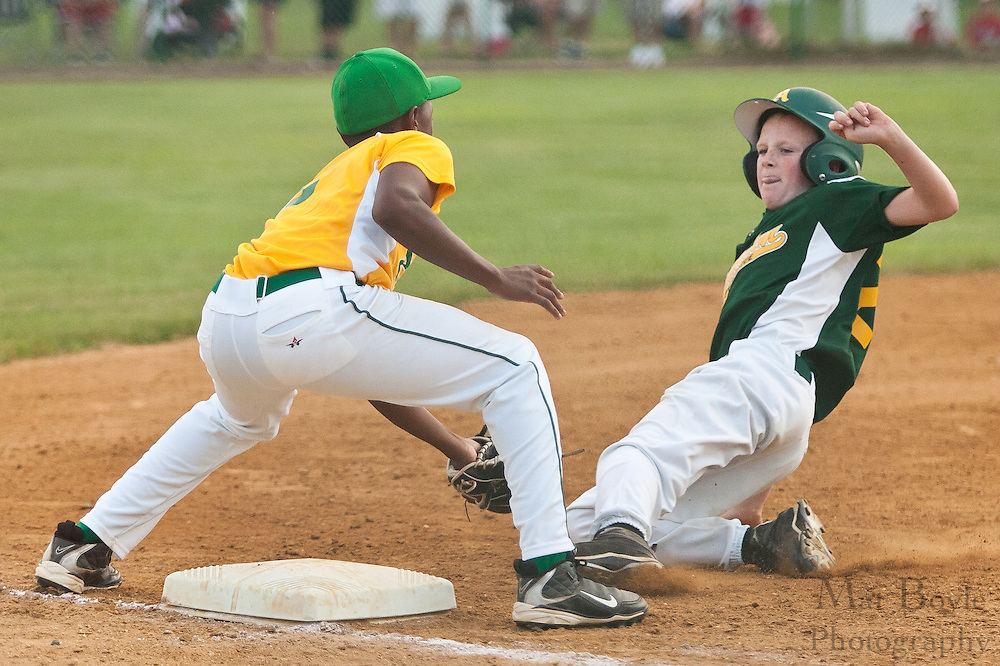 Erial's pitcher Adam Holland, covering third base, tags out Audubon's Colin Felix as he tries to advance to third base during the District 14 Little League final against Audubon held in Gloucester on Wednesday July 13th.
