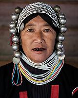 KYAING TONG, MYANMAR - CIRCA DECEMBER 2017: Portrait of an Akha woman at the Wan Pin Akha Village in Kyaing Tong.