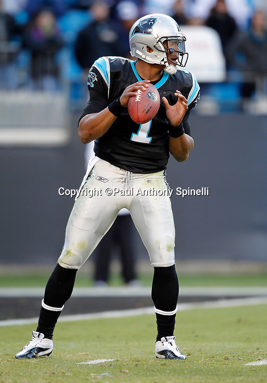 Carolina Panthers quarterback Cam Newton (1) drops back to pass during the NFL week 14 football game against the Atlanta Falcons on Sunday, December 11, 2011 in Charlotte, North Carolina. The Falcons won the game 31-23. ©Paul Anthony Spinelli