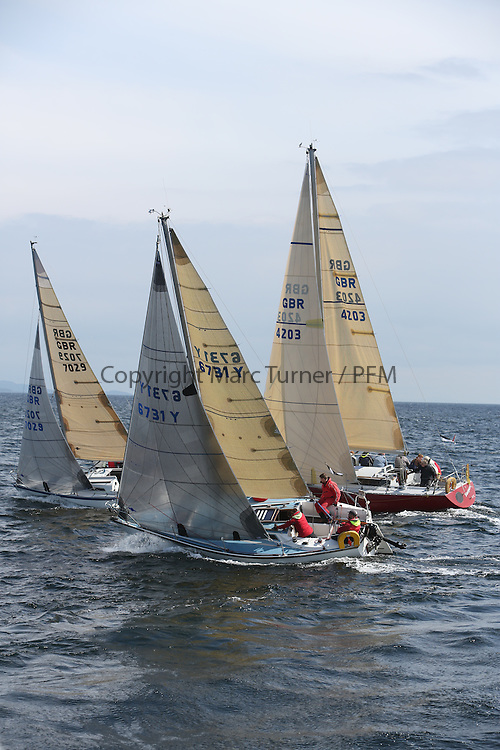 The Silvers Marine Scottish Series 2014, organised by the  Clyde Cruising Club,  celebrates it's 40th anniversary.<br /> Day 2, Sigma, CYCA Class 6 start, GBR7029, Farr e Nuff, John Kent, LSC/FYC, Farr 727, K4203, Stargazer, G. MacLeod/A. Bisland, CCC / Arran YC , Grand Soleil 34, 6731Y , Zebedee, L. Downie / G. Wilson , FYC , GK24<br /> Racing on Loch Fyne from 23rd-26th May 2014<br /> <br /> Credit : Marc Turner / PFM