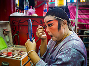 17 OCTOBER 2018 - BANGKOK, THAILAND:  A performer puts on his makeup before the Chinese opera on the last night of the Vegetarian Festival at Chit Sia Ma Shrine in Bangkok's Chinatown. The Vegetarian Festival, also called the Nine Emperor Gods Festival, is a nine-day Taoist celebration beginning on the eve of 9th lunar month of the Chinese calendar. Traditional Chinese operas, called Ngiew in Thailand, are sponsored at many Chinese shrines and temples during the Vegetarian Festival.     PHOTO BY JACK KURTZ