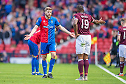 Shaun Rooney (#2) of Inverness Caledonian Thistle FC questions Uche Ikpeazu (#19) of Heart of Midlothian FC for not putting the ball out of pay to allow treatmen to an injured player during the William Hill Scottish Cup semi-final match between Heart of Midlothian and Inverness CT at Hampden Park, Glasgow, United Kingdom on 13 April 2019.