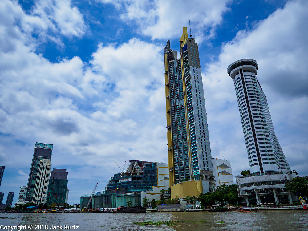 17 SEPTEMBER 2018 - BANGKOK, THAILAND: The ICONSIAM development, nestled between condominiums and hotels, as seen from the Bangkok side of the Chao Phraya River. ICONSIAM is a mixed-use development on the Thonburi side of the Chao Phraya River. It is expected to open in 2018 and will include two large malls, with more than 520,000 square meters of retail space, an amusement park, two residential towers and a riverside park. It is the first large scale high end development on the Thonburi side of the river and will feature the first Apple Store in Thailand and the first Takashimaya department store in Thailand.      PHOTO BY JACK KURTZ