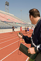 Trainer timing runners on track