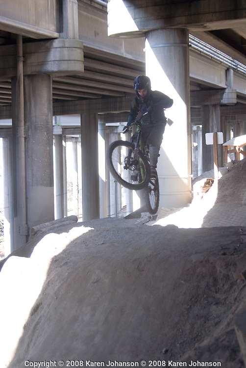 Rider on the intermediate jump line at the Colonnade bike skills park in Seattle, Wash.