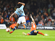 Luton Town player Glen Rea tackles Neil Danns of Blackpool in the first half during the EFL Sky Bet League 2 play off second leg match between Luton Town and Blackpool at Kenilworth Road, Luton, England on 18 May 2017. Photo by Ian  Muir.