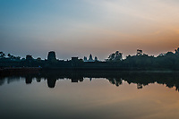 tourist entering Angkor Wat panorama viewed across the moat at Cambodia