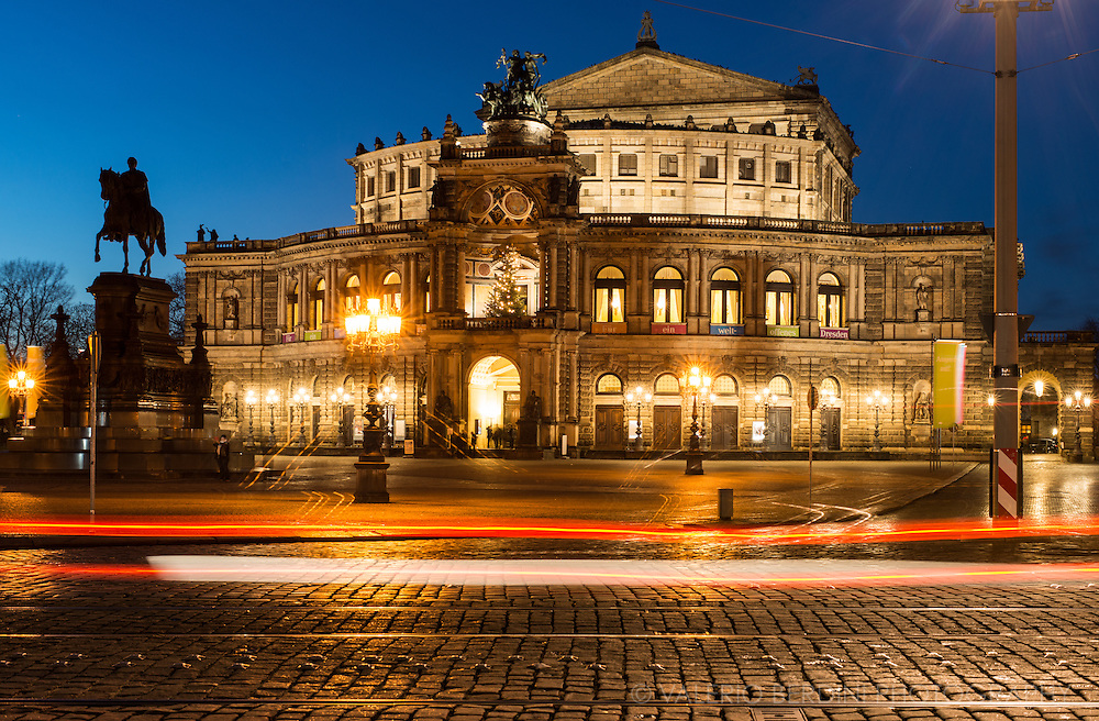 Cars in front of the Semperoper Opera house in Dresden, Germany. Built by architect Semper in 1841, and rebuilt after a fire devastated it, in 1869.