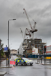 © Licensed to London News Pictures. 28/03/2016. London, UK. A collapsed tower crane on a construction site in Creek Road, Greenwich, south east London. The crane collapsed during the windy weather of storm Katie.  Photo credit : Vickie Flores/LNP