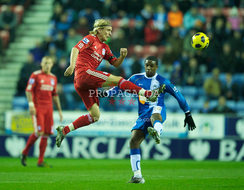 WIGAN, ENGLAND - Wednesday, November 10, 2010: Liverpool's Christian Poulsen and Wigan Athletic's Charles N'Zogbia during the Premiership match at the DW Stadium. (Photo by David Rawcliffe/Propaganda)