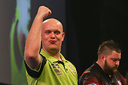 Michael van Gerwen celebrates winning the Sid Waddell Trophy punching the air during the 2019 William Hill World Darts Championship Final at Alexandra Palace, London, United Kingdom on 1 January 2019.