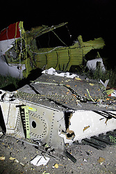 Image ©Licensed to i-Images Picture Agency. 17/07/2014.<br /> 61849946<br /> Shakhtarsk, Ukraine. The debris at the crash site of a passenger near the city of Shakhtarsk in Ukraine's Donetsk region. The crash of a Malaysian passenger plane in Ukraine on Thursday was shrouded in mystery of a deliberate attack, with Kiev trading accusations of blame with separatists and Moscow. Photo by imago / i-Images.<br /> <br /> UK ONLY