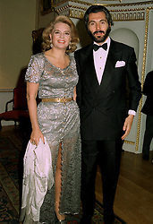 PRINCESS IRA VON FURSTENBURG and MR CESARE CANAVESIO,  at a dinner in London on 26th June 1997.LZT 38