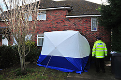 © Licensed to London News Pictures. 30/03/2016<br /> Police and a forensics tent at the scene where two people have been killed at a property in Dickens Avenue, Canterbury, Kent. Officers said they found two people with fatal injuries and two other people injured. Police have arrested a man at the property. Photo credit: Grant Falvey/LNP