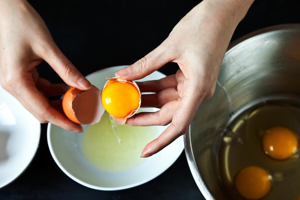 Cracking egg into a bowl