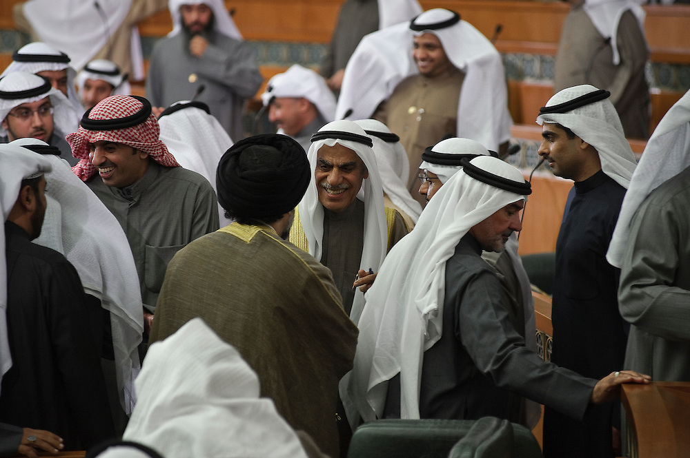 Member of Parliament Ahmad Al-Sadoun smiles as MPs congratulate him on his election as the Speaker of Parliament during the inaugural session of the new National Assembly Feb. 15, 2012 in Kuwait City. It was the fourth time Sadoun, a veteran MP, holds the post of speaker. Kuwaitis voted Feb. 2 for a new 50-member National Assembly (parliament).
