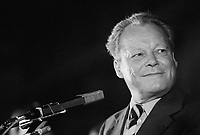 ca. September 1976, Dortmund, West Germany --- Willy Brandt, Chairman of the Social Democratic Party (SPD) and former chancellor, speaks at a SPD rally during the 1976 chancellor election. Incumbent Chancellor Helmut Schmidt of the SPD would prevail over Helmut Kohl during this election. --- Image by © Owen Franken/CORBIS