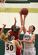 Xavier's Ashley Stulken (50) blocks a shot by Washington's Abby Herb (3) during the 2013 Eastern Iowa All-Star Basketball Game at Iowa City West High School in Iowa City on Wednesday, March 27, 2013. The North (white) defeated the South (dark) 68-65.