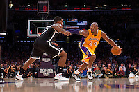 20 November 2012: Guard (24) Kobe Bryant of the Los Angeles Lakers drives to the basket while being guarded by (7) Joe Johnson of the Brooklyn Nets during the first half of the Lakers 95-90 victory over the Nets at the STAPLES Center in Los Angeles, CA.