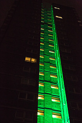 "London, UK. 14th June, 2018. The Green for Grenfell illuminations are lit at the Grenfell Tower and the twelve closest tower blocks (seen here Dixon House on the Silchester West Estate) on the first anniversary of the fire in a display intended to 'shine a light"" of love and solidarity for all those affected and to raise awareness of the plight of those still without new homes after one year. Green for Grenfell is a community-led initiative in collaboration with tenants' and residents' associations and Grenfell United."