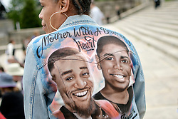 Angela Mojica, of NorthEast Philadelphia, remembers her slain son Basil Adams (pictured left) who lost its life to gun violence in 2017. The mother is joined by an estimated 250-350 at the Art Museum steps in Philadelphia, PA to protest gun violence, on June 11, 2018.