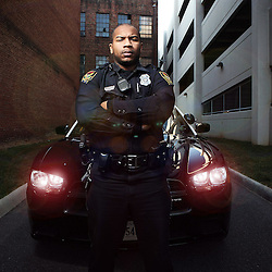 Kyle Green | The Roanoke Times<br /> 1/20/2012 Officer R.A. Robinson, a three year veteran of the Roanoke City police force, helped catch three robbers in October by chasing their car on foot for three blocks in Old Southwest. Officer Robinson has been named officer of the year.