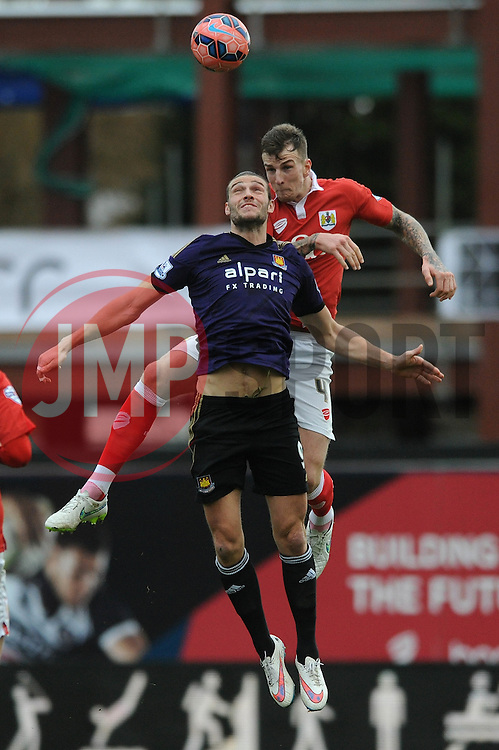 West Ham's Andy Carroll challenges for the header with Bristol City's Aden Flint - Photo mandatory by-line: Dougie Allward/JMP - Mobile: 07966 386802 - 25/01/2015 - SPORT - Football - Bristol - Ashton Gate - Bristol City v West Ham United - FA Cup Fourth Round