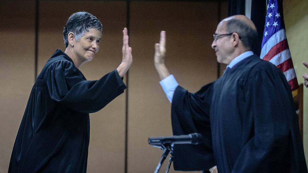 rer060717f/A1/June 07, 2017/Albuquerque Journal<br /> The Swearing-In Ceremony of the Honorable Judith K. Nakamura as Chief Justice of the Supreme Court of New Mexico took place Wednesday afternoon at the Marriott Pyramid.  Pictured is Chief Justice Judith Nakamura(cq),left, giving a high five to Justice Edward Chavez(Cq) after her remarks.<br />  Roberto E. Rosales/Albuquerque Journal