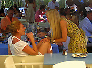 **EXCLUSIVE**.Duchess of York, Sarah Ferguson, Princess Beatrice, Princess Eugenie.Club 55 Restaurant .St. Tropez, France..Sunday, July 29, 2007.Photo By Celebrityvibe.com.To license this image please call (212) 410 5354; or.Email: celebrityvibe@gmail.com ;.